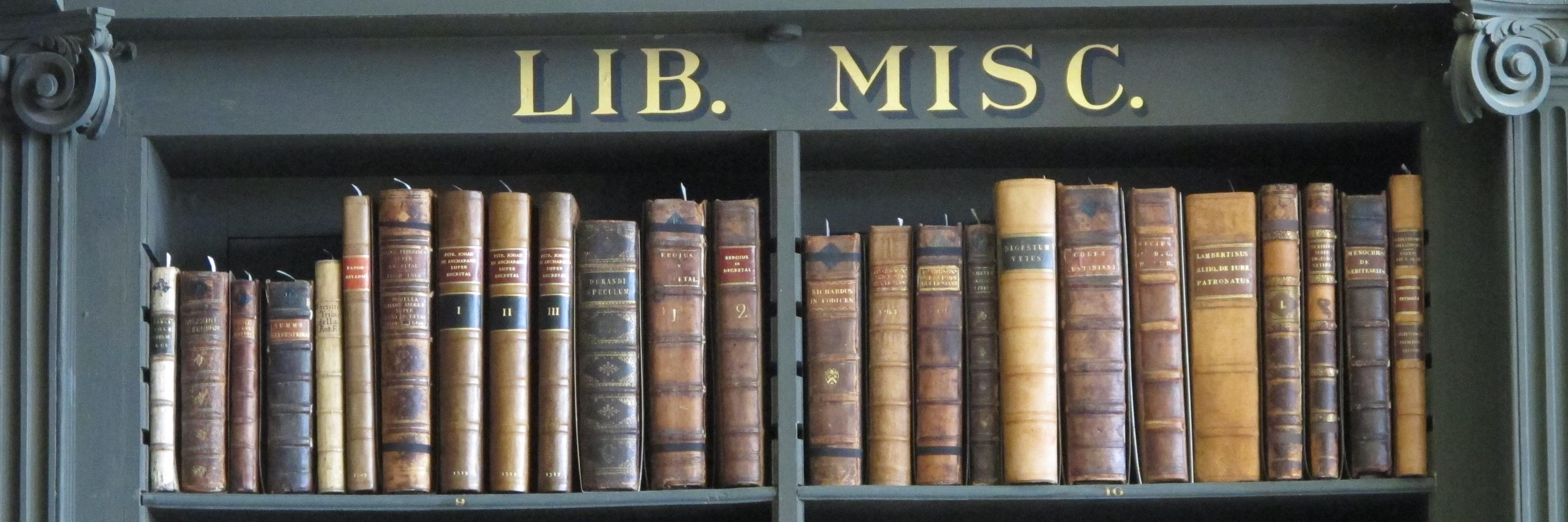 Shelf of books; with label 'Lib. Misc' above